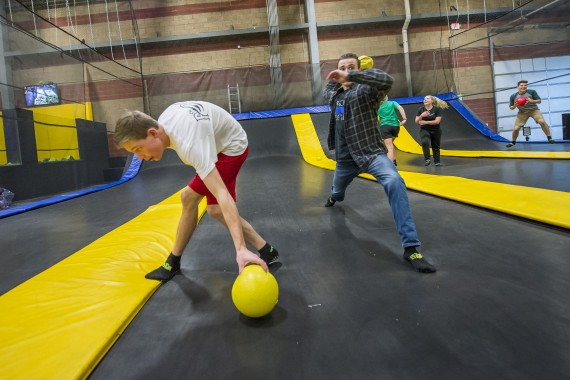 teenagers playing dodge ball